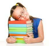 Little girl is sleeping on her books Stock Image