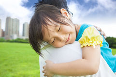 Little girl sleeping on his father shoulder. Smiling little girl sleeping on his father shoulder Royalty Free Stock Photography