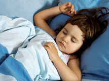 Little Girl Sleeping In Her Bed Stock Images