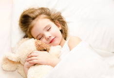 Little Girl Sleeping In The Bed With Her Toy Royalty Free Stock Photography