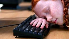 Little girl sleeping on keyboard. In elementary school stock video footage