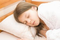 A little girl is sleeping Stock Image