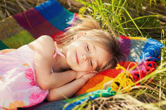 Little girl sleeping on nature Royalty Free Stock Photography