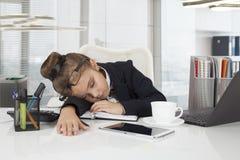 Little girl sleeping in the office Stock Photos