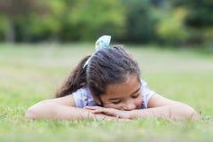 Little girl sleeping in a park Royalty Free Stock Photos