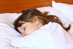 Little girl sleeping peacefully in her bed Royalty Free Stock Photo