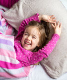 Little girl sleeping in a pink bed. Little cute girl sleeping in the pink bed,the concept of childhood and holiday stock photo