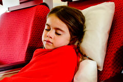 Little girl sleeping in a plane Royalty Free Stock Photo