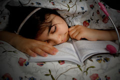 Little girl sleeping after reading Royalty Free Stock Image
