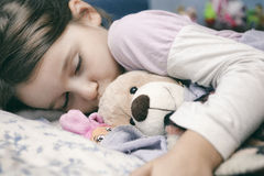 Little girl sleeping safely stock photography