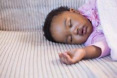 Little girl sleeping on the sofa Stock Photos