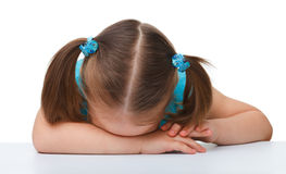 Little girl is sleeping at table Stock Image