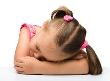 Little girl is sleeping at table Stock Photos
