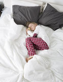 Little girl sleeping with teddy bear Royalty Free Stock Photos