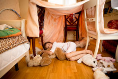 Little girl sleeping on teddy bear at bedroom Stock Images