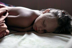 Little girl is sleeping well in her bed. In the earlier morning (in dark key Royalty Free Stock Photo