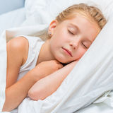 Little girl sleeping in white bed Royalty Free Stock Image