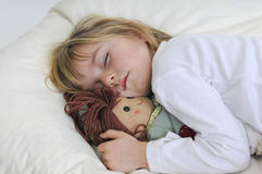 Little girl sleeps Stock Photos