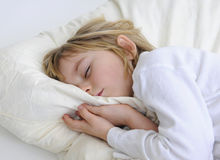 Little girl sleeps Stock Images