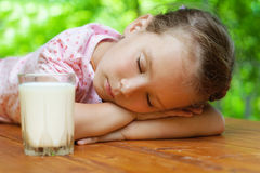 Little girl sleeps around glass Royalty Free Stock Photo