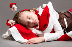 Little girl sleeps in Christmas Eve Royalty Free Stock Image