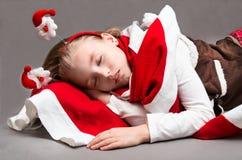 Little girl sleeps in Christmas Eve Royalty Free Stock Image