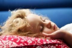 Little girl sleeps on a sofa Royalty Free Stock Photos