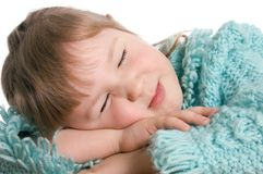 Little girl sleeps on a table Royalty Free Stock Photography