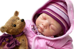 Little girl sleeps with teddy bear Stock Photos