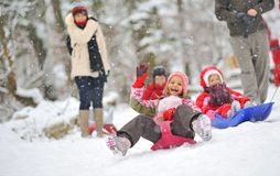 Little girl on sleigh Stock Image