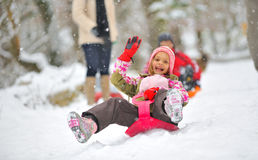 Little girl on sleigh Stock Photography