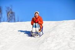 Little girl on sleigh Stock Photo