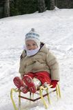 Little girl on a sleigh Royalty Free Stock Photos