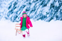 Little girl on a sleigh ride Stock Image