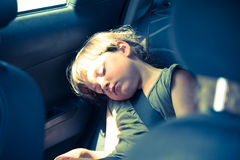 Little girl slepping on back seat. Little girl slepping on car's back seat Royalty Free Stock Image