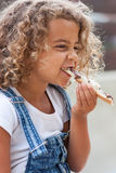 Little girl and slice of bread Royalty Free Stock Image
