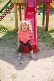 Little girl on the slide Royalty Free Stock Photography