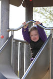 Little girl on a slide Stock Photos