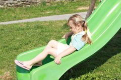 Little girl on slide Stock Photography