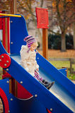 Little girl on the slide Royalty Free Stock Image