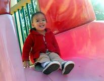 Little girl on slide Stock Photography