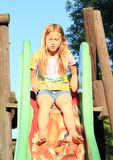 Little girl on a slide Stock Photo