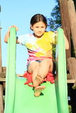 Little girl on a slide Royalty Free Stock Photos