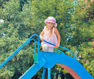 Little girl on the slide Stock Photography