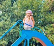 Little girl on the slide Stock Photography