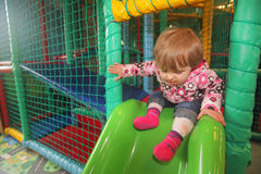 Little girl on a slide Royalty Free Stock Photo