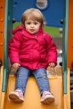 Little girl on a slide Stock Photos