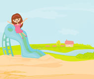 Little girl on slide Royalty Free Stock Photography