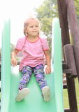 Little girl on slide Stock Image