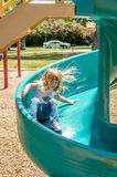 Little girl on slide Stock Photos